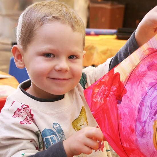 Gift Aid Thumbnail - Child with painting